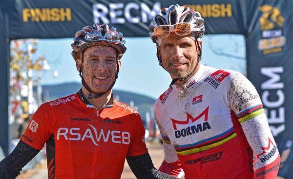 Mountain bikers Nico Pfitzenmaier (right) and Renay Groustra powered through the Fisantehoek forest en route to victory in the first stage of the RECM Knysna 200 on Friday.  Photo: Full Stop Communications